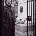 Author Michael Vain standing at the gate to Poe's Tomb, Baltimore Md.